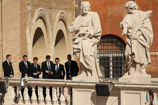 VATICAN CITY, VATICAN - FEBRUARY 27:  Men observe St Peter's Square before Pope Benedict XVI's final weekly public audience on February 27, 2013 in Vatican City, Vatican.  The Pontiff has attended his last weekly public audience before stepping down tomorrow. Pope Benedict XVI has been the leader of the Catholic Church for eight years and is the first Pope to retire since 1415. He cites ailing health as his reason for retirement and will spend the rest of his life in solitude away from public engagements. Photo: Oli Scarff, Getty Images / 2013 Getty Images