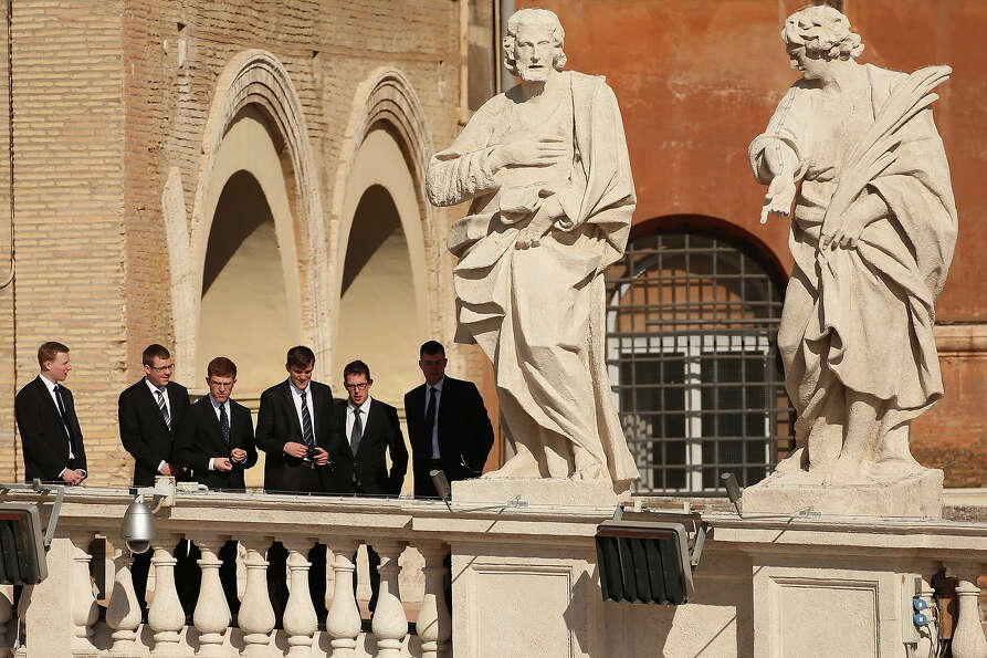 VATICAN CITY, VATICAN - FEBRUARY 27:  Men observe St Peter's Square before Pope Benedict XVI's final