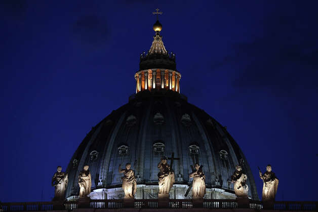 VATICAN CITY, VATICAN - FEBRUARY 26:  The sun sets behind St Peter's Basilica on February 26, 2013 in Vatican City, Vatican. The Pontiff will hold his last weekly public audience on February 27, 2013 before he retires the following day. Pope Benedict XVI has been the leader of the Catholic Church for eight years and is the first Pope to retire since 1415. He cites ailing health as his reason for retirement and will spend the rest of his life in solitude away from public engagements. Photo: Oli Scarff, Getty Images / 2013 Getty Images