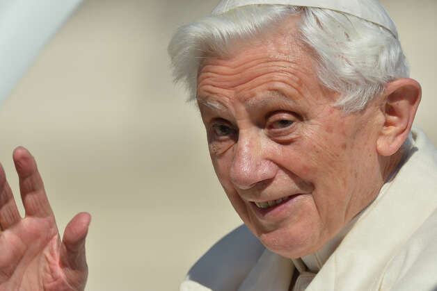 Pope Benedict XVI waves from the altar as he arrives on St Peter's square for his last weekly audience on February 27, 2013 at the Vatican. Pope Benedict XVI will hold the last audience of his pontificate in St Peter's Square on Wednesday on the eve of his historic resignation as leader of the world's 1.2 billion Catholics.      AFP PHOTO / GABRIEL BOUYS Photo: AFP, AFP/Getty Images / 2013 AFP