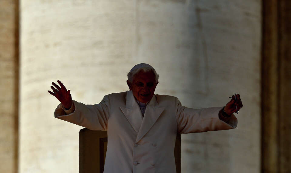 Pope Benedict XVI walks to the altar as he arrives on St Peter's square for his last weekly audience