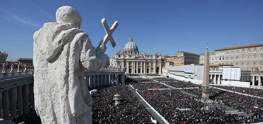 VATICAN CITY, VATICAN - FEBRUARY 27:  Thousands gather in St Peter's Square as Pope Benedict XVI attends his last weekly audience on February 27, 2013 in Vatican City, Vatican.  The Pontiff has attended his last weekly public audience before stepping down tomorrow. Pope Benedict XVI has been the leader of the Catholic Church for eight years and is the first Pope to retire since 1415. He cites ailing health as his reason for retirement and will spend the rest of his life in solitude away from public engagements. Photo: Peter Macdiarmid, Getty Images / 2013 Getty Images