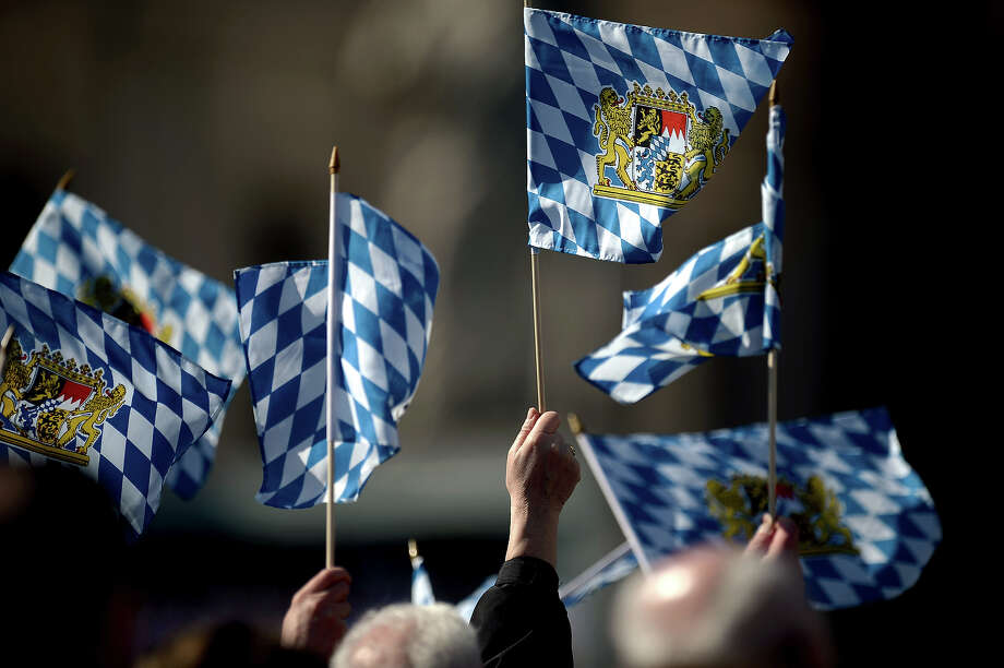 Faithful waves flags from Bavaria during Pope Benedict XVI's last weekly audience on February 27, 2013 at St Peter's square at the Vatican. Pope Benedict XVI will hold the last audience of his pontificate in St Peter's Square on Wednesday on the eve of his historic resignation as leader of the world's 1.2 billion Catholics.        AFP PHOTO / FILIPPO MONTEFORTE Photo: AFP, AFP/Getty Images / 2013 AFP