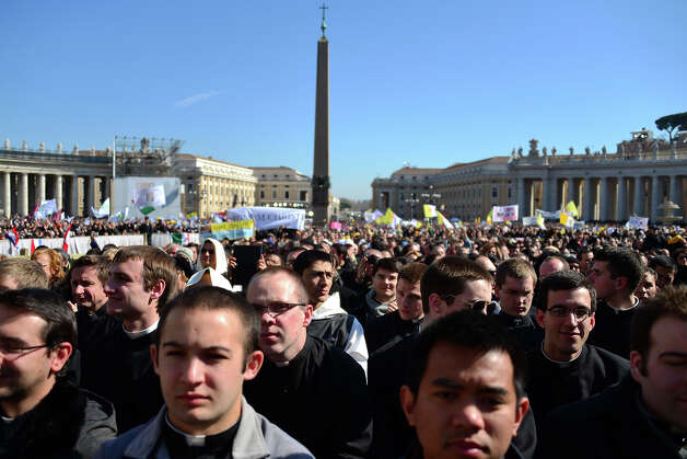 Faithful attend Pope Benedict XVI's last weekly audience on February 27, 2013 at St Peter's square at the Vatican. Pope Benedict XVI will hold the last audience of his pontificate in St Peter's Square on Wednesday on the eve of his historic resignation as leader of the world's 1.2 billion Catholics.      AFP PHOTO / GABRIEL BOUYS Photo: AFP, AFP/Getty Images / 2013 AFP