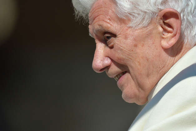 Pope Benedict XVI arrives in his papamobile at the end of his last weekly audience on February 27, 2013 at St Peter's square at the Vatican. Pope Benedict XVI will hold the last audience of his pontificate in St Peter's Square on Wednesday on the eve of his historic resignation as leader of the world's 1.2 billion Catholics.      AFP PHOTO / GABRIEL BOUYS Photo: AFP, AFP/Getty Images / 2013 AFP