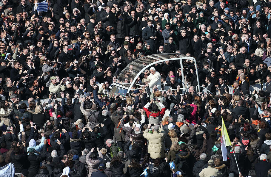 VATICAN CITY, VATICAN - FEBRUARY 27:  Pope Benedict XVI waves to the faithful from the Popemobile as