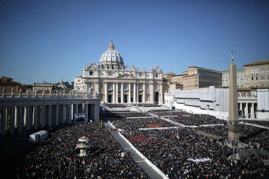 VATICAN CITY, VATICAN - FEBRUARY 27:  The faithful fill St Peter's Square as Pope Benedict XVI atten