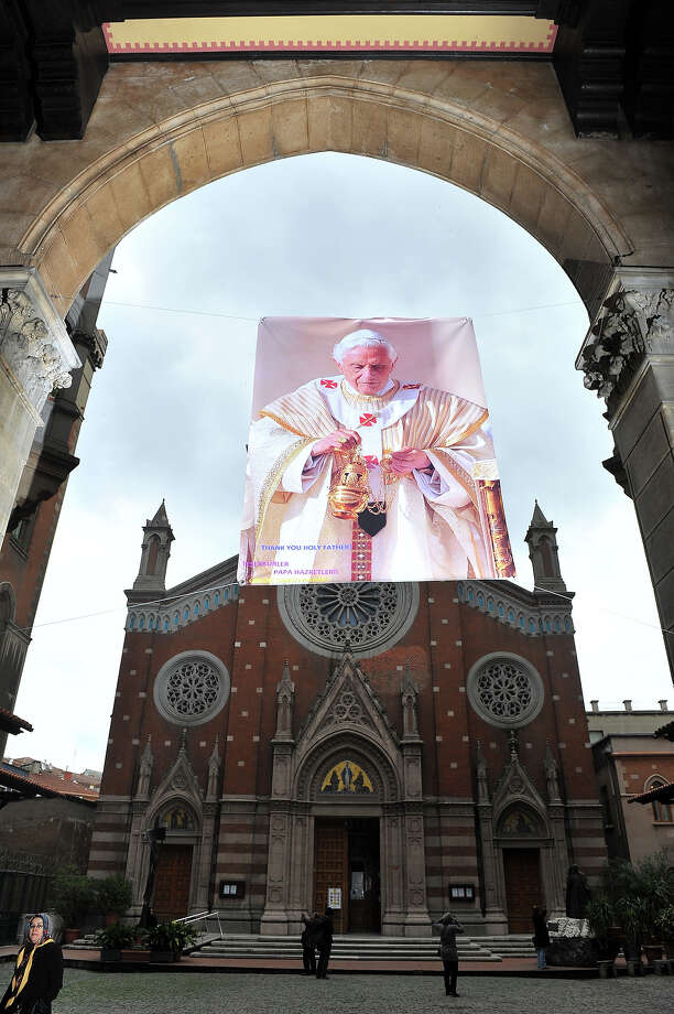 "A poster showing Pope Benedict XVI portrait is hanged  in front of St. Anthony of Padua Church reading ""Thank you holy father"" on February 27, 2013 in Istanbul.  Pope Benedict XVI will hold the last audience of his pontificate in St Peter's Square on Wednesday on the eve of his historic resignation as leader of the world's 1.2 billion Catholics. AFP PHOTO/BULENT KILIC Photo: BULENT KILIC, AFP/Getty Images / 2013 AFP"