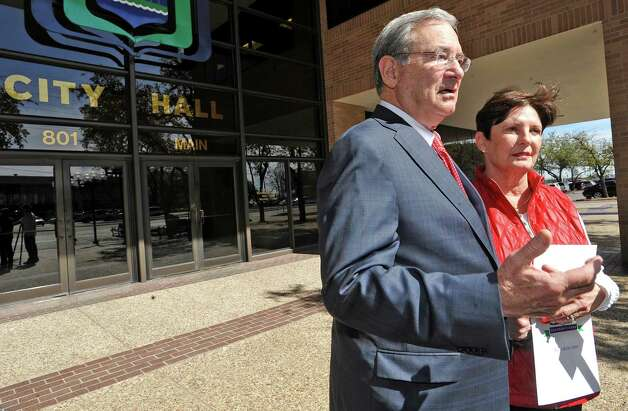 Lamar President Jimmy Simmons, left, and his wife Susan, right, leave City Hall and speak with the media. On Tuesday, February 26, 2013, the Beaumont City Council, during their regular meeting, voted unanimously on an ordinance renaming a street after Lamar University President Jimmy Simmons. A portion of University Drive, that is between E. Cardinal Drive and E. Lavaca Street, will be renamed Jimmy Simmons Boulevard.   Council also gave him and his wife Susan a Proclamation. Dave Ryan/The Enterprise Photo: Dave Ryan