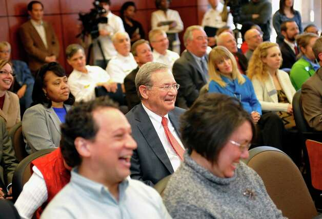 Lamar President Jimmy Simmons, center, laughs as the Beaumont City Council voted to award a street name change in his honor. On Tuesday, February 26, 2013, the Beaumont City Council, during their regular meeting, voted unanimously on an ordinance renaming a street after Lamar University President Jimmy Simmons. A portion of University Drive, that is between E. Cardinal Drive and E. Lavaca Street, will be renamed Jimmy Simmons Boulevard.   Council also gave him and his wife Susan a Proclamation. Dave Ryan/The Enterprise Photo: Dave Ryan