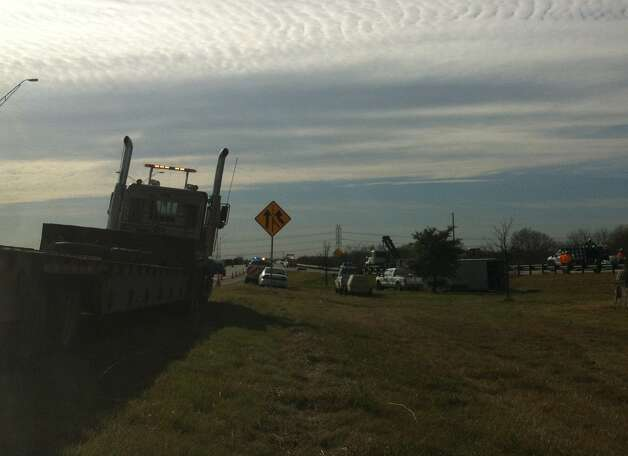 Crews work to clear acid spilled when an 18-wheeler went rolling over along interstate 37 Tuesday evening. Photo: Ana Ley/Express-News