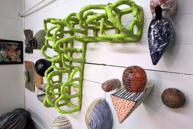 Ceramic wall hangings are displayed as Alex and Ann Marie Comminos show their gallery in the Lone Star Art District on January 29, 2013. Photo: Tom Reel, San Antonio Express-News / ©2012 San Antono Express-News
