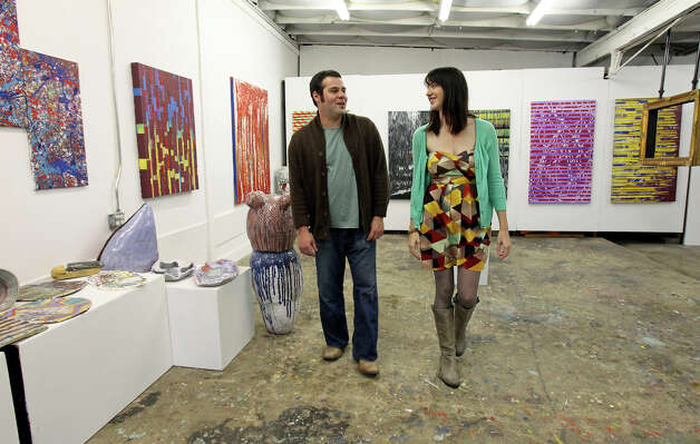 Alex and Ann Marie Comminos talk as they show their gallery in the Lone Star Art District on January 29, 2013. Photo: Tom Reel, San Antonio Express-News / ©2012 San Antono Express-News