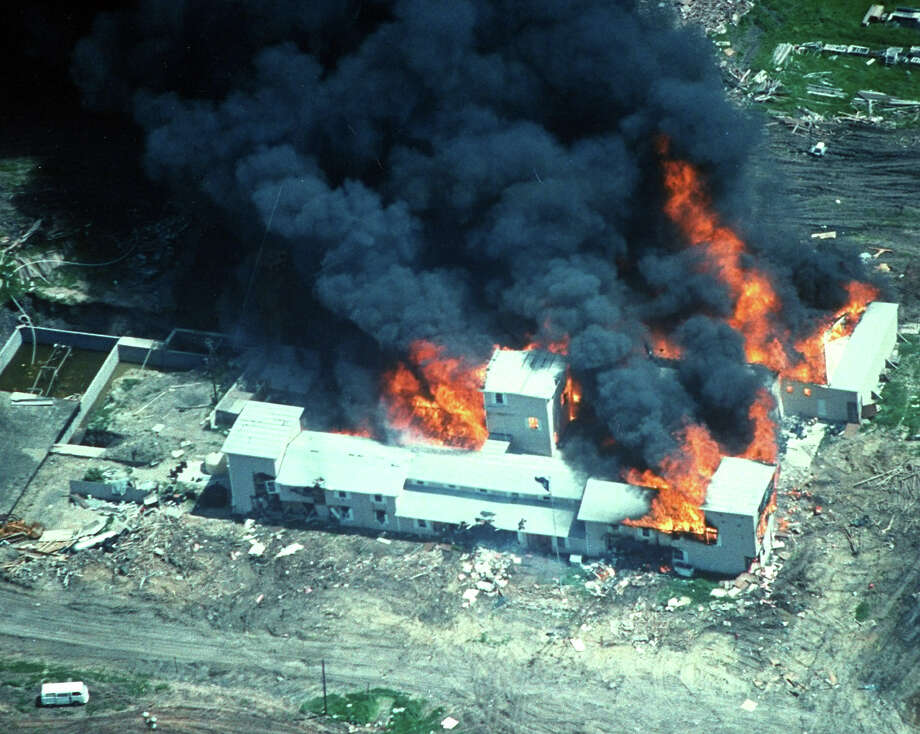 Overhead of smoking fire consuming David Koresh-led Branch Davidian cult compound, believed set by cult after FBI/ATF teargassing in effort to end siege  Photo: Time Life Pictures, Time & Life Pictures/Getty Image / Time Life Pictures