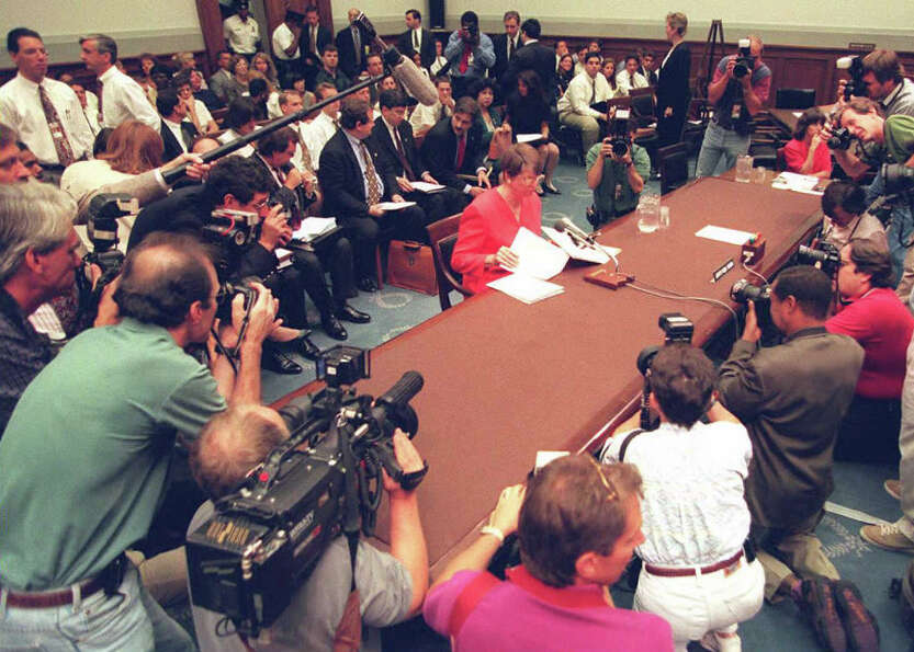 US Attorney General Janet Reno is surrounded by photographers before testifying to a congressional s