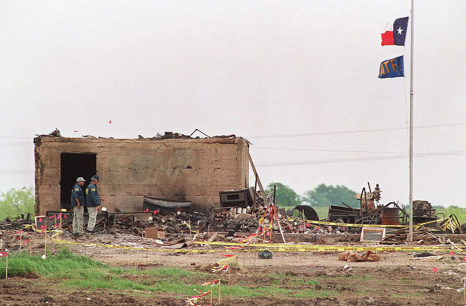 WACO, TX - APRIL 23:  Agents of the Bureau of Alcohol, Tobacco and Firearms (ATF) shown in a file photo dated 23 April 1993 inspecting the only structure that was left standing after a fire destroyed the Branch Davidian cult compound 19 April 1993.  After a shootout in Waco in 1993 that killed four federal agents and six members of the Branch Davidian religious sect, authorities negotiated with cult leader David Koresh for 51 days. On the final day, 19 April 1993, a few hours after a government tank rammed the cult's wooden fortress, the siege ended in a fiery blaze, killing Koresh and 80 of his followers. Photo: DAVID AKE, AFP/Getty Images / AFP