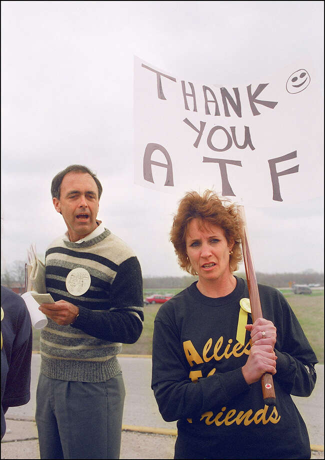 Ceji Ashby of Waco (R), a supporter of the Bureau of Alcohol, Tobacco and Firearms (ATF), shown in a file photo dated 21 March 1993 turning away after arguing with a demonstrator Jerald Finney of Austin at a roadblock near the Branch Davidian. After a shootout in Waco in 1993 that killed four federal agents and six members of the Branch Davidian religious sect, authorities negotiated with cult leader David Koresh for 51 days. On the final day, 19 April 1993, a few hours after a government tank rammed the cult's wooden fortress, the siege ended in a fiery blaze, killing Koresh and 80 of his followers. Photo: BOB DAEMMRICH, AFP/Getty Images / AFP