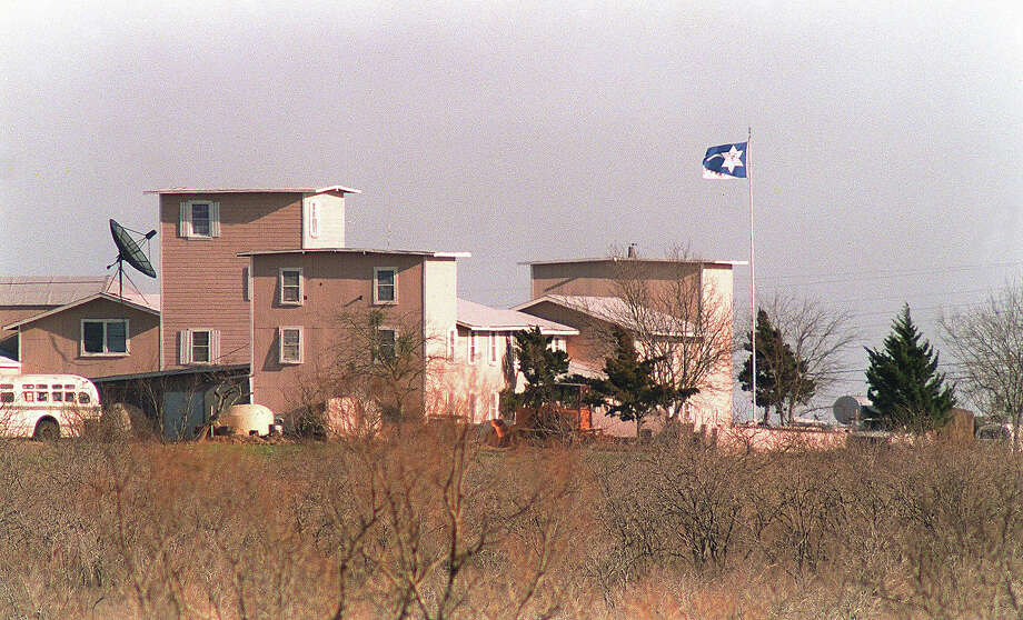A cult flag shown in a file photo dated 08 March 1993 flying over the Branch Davidian compound in Waco. After a shootout in Waco in 1993 that killed four federal agents and six members of the Branch Davidian religious sect, authorities negotiated with cult leader David Koresh for 51 days. On the final day, 19 April 1993, a few hours after a government tank rammed the cult's wooden fortress, the siege ended in a fiery blaze, killing Koresh and 80 of his followers. Photo: BOB STRONG, AFP/Getty Images / 2012 AFP