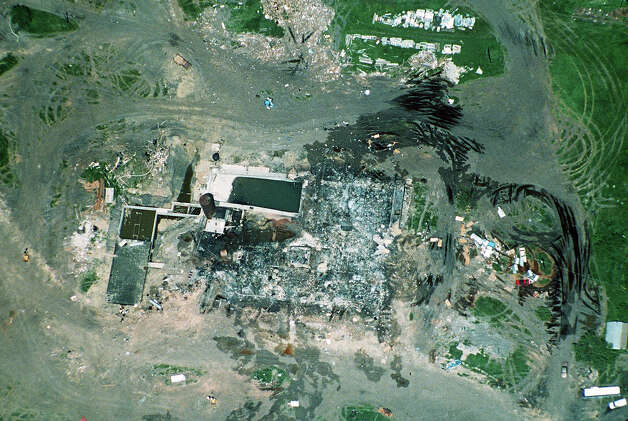 This aerial view of the destroyed Branch Davidian compound near Waco, Texas, was made on April 20, 1993 from an aircraft at 8,500 feet: the height restriction made by federal authorities. Photo: TANNEN MAURY, ASSOCIATED PRESS / AP1993