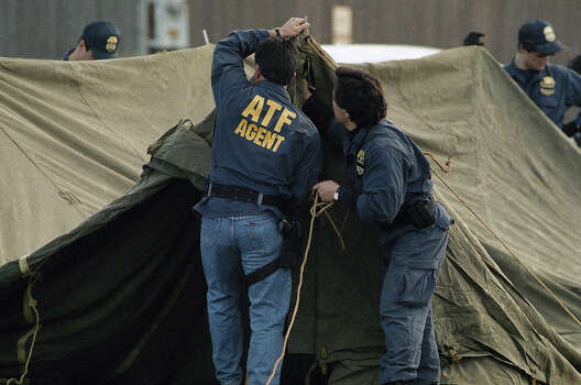 More: Koresh's impact is still feltAgents of the Bureau of Alcohol, Tobacco and Firearms set up a tent at the command post on the campus of Texas State Technical Institute in Waco, Texas on Tuesday, March 2, 1993. Photo: Rick Bowmer, AP / AP