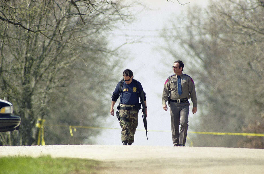 Two law enforcement officials walk along a country road near the Branch Davidians compound outside Waco, Texas on Saturday, March 6, 1993. Photo: Rick Bowmer, AP / AP