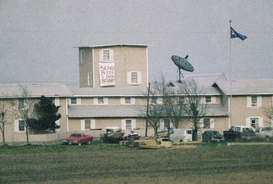 "A banner reading ""Send in CFA and Don Stuart"" hangs from the watch tower of the Branch Davidian compound near Waco, Texas on Wednesday, March 10, 1993. This is the second day cult members have hung a banner asking the press and others for help. The CFA, or Constitution Foundational Association, is a conservative group highly critical of the federal government. Stewart has been identified as someone experience in negotiations. Photo: Rick Bowmer, AP / AP"
