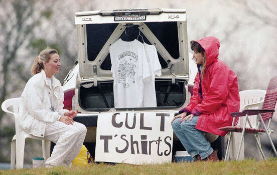 Two entrepreneurs, Stacey Boiles, 26, left, and Jane Lupfer, 28, both of Waco, Texas, set up shop with their Branch Davidian cult T-shirts near the cult's compound in Waco, Texas on Friday, March 20, 1993. The cult has been under siege since February 28 when federal agents tried to serve a search and arrest warrant on cult leader David Koresh. Photo: Rick Bowmer, AP / AP