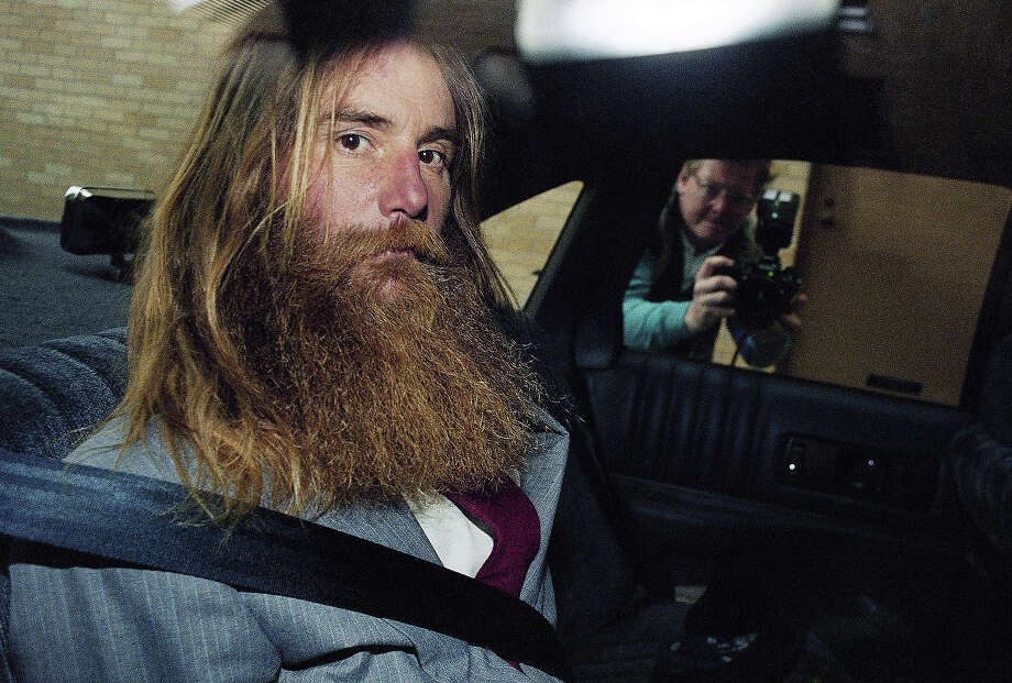 An unidentified man rides in the back of a Texas Dept. of Pubic Saftey vehicle as he arrives at the county jail after he walked out of the Branch Davidian compound in Waco, Texas on Sunday, April 4, 1993. Photo: Ron Heflin, AP / AP