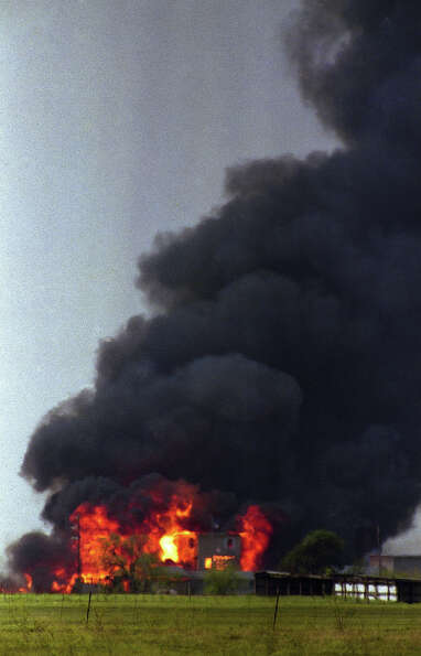 Flames engulf the Branch Davidian compound near Waco, Texas on April 19, 1993. The Justice Departmen