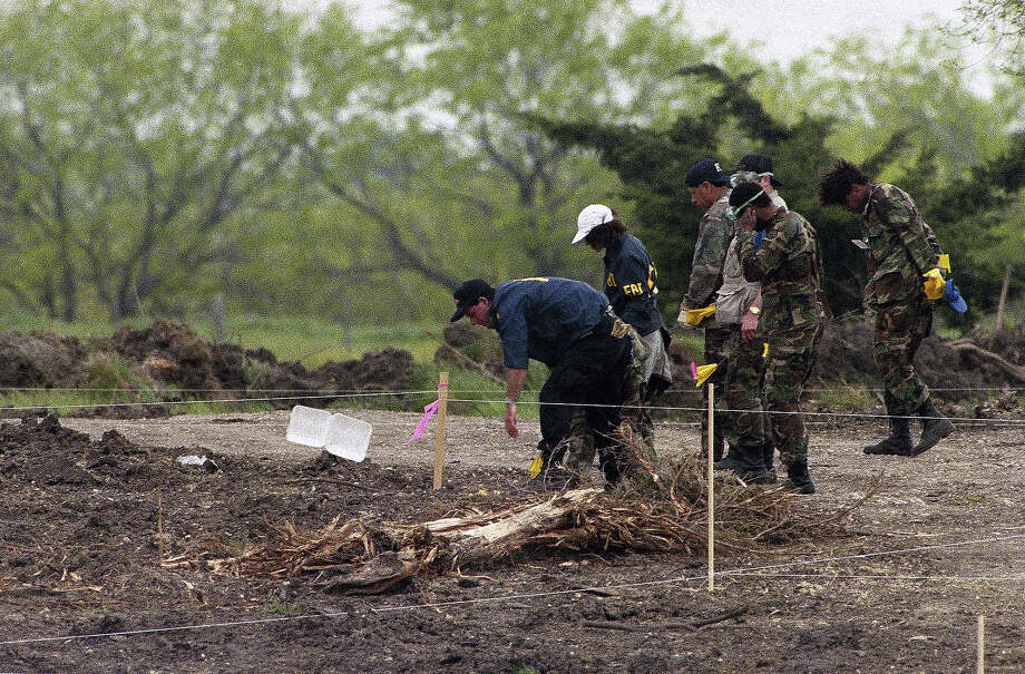 Investigators search for evidence in the rubble of the former Branch Davidian compound near Waco, Texas on Friday, April 23, 1993. The religious cultís stronghold was destroyed in a fire on Monday. Photo: Ron Heflin, AP / AP