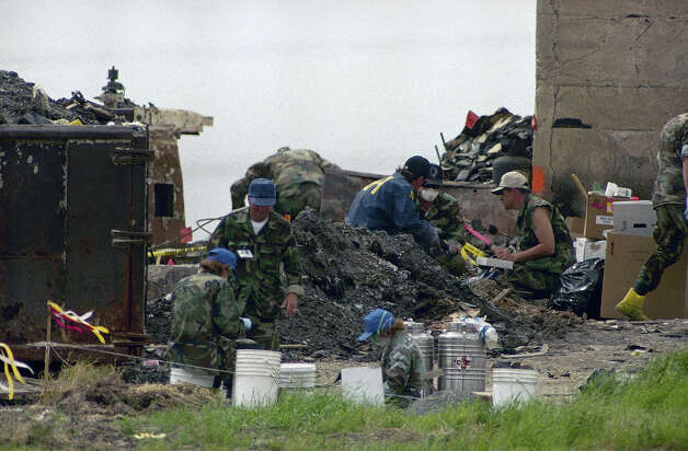 Investigators search for clues in the rubble of the destroyed Branch Davidian compound near Waco, Texas on Tuesday, April 27, 1993. Independent fire arson investigators announced Monday they have concluded the cultists themselves set the fire that destroyed the compound. Photo: Ron Heflin, AP / AP