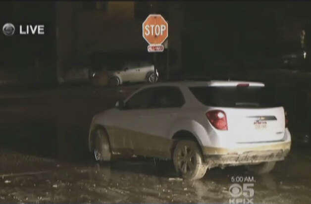 A water main break flooded cars and homes in San Francisco's West Portal neighborhood early Wednesday morning. Photo: CBS San Francisco