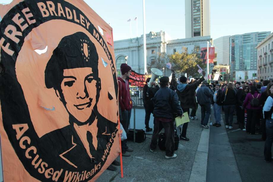 A sign supporting Bradley Manning hangs outside a campaign event for President Barack Obama in San Francisco on Monday, Oct. 8, 2012. (AP Photo/Mathew Sumner) Photo: Mathew Sumner, Associated Press / FR170005 AP