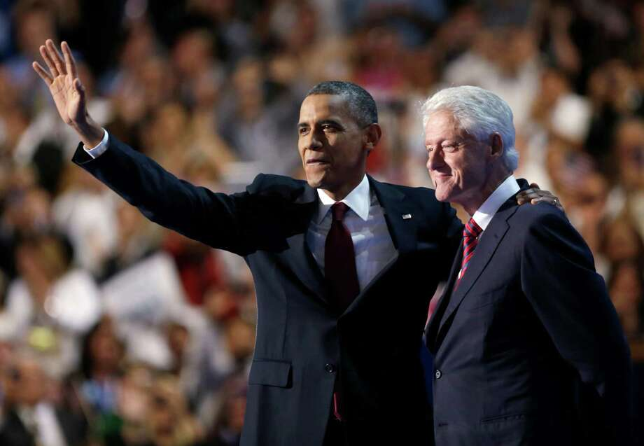 FILE - In this Wednesday, Sept. 5, 2012 file photo, President Barack Obama waves after former President Bill Clinton addressed the Democratic National Convention in Charlotte, N.C. President Obama caps the convention Thursday, Sept. 6, with a prime time acceptance speech aimed at forcefully making his case for re-election: The economy is still weak but getting better, and America is absolutely better off than when he took office in perilous times. (AP Photo/David Goldman, File) Photo: David Goldman, Associated Press / AP