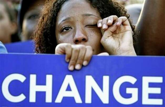 Janelle Wells-LoIacono from Orange City, Fla., wipes as tear as Democratic presidential candidate Sen. Barack Obama, D-Ill., speaks with Sen. Hillary Rodham Clinton, D-N.Y., at rally at the Amway Arena in Orlando, Monday, Oct. 20, 2008. Photo: Alex Brandon, AP / AP