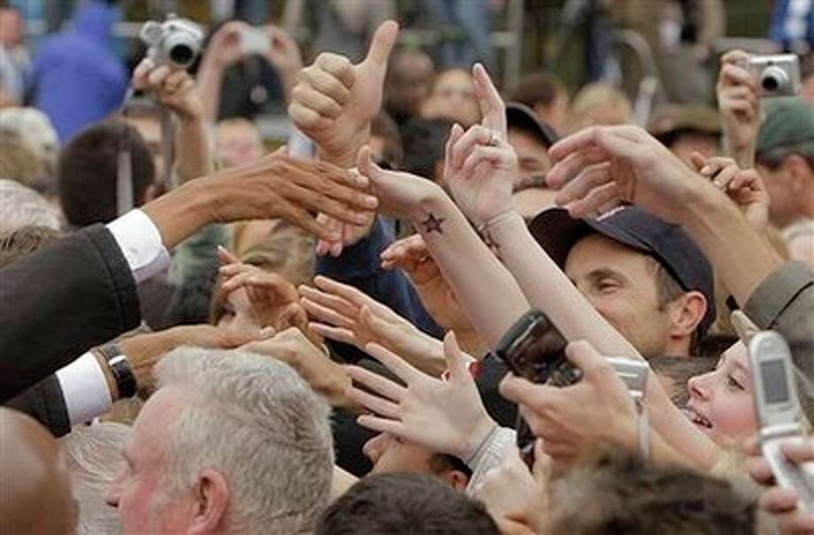 Democratic presidential candidate, Sen. Barack Obama, D-Ill., left, shakes hands with supporters at a community event in Londonderry, N.H., Thursday, Oct. 16, 2008. Photo: Jae C. Hong, AP / AP