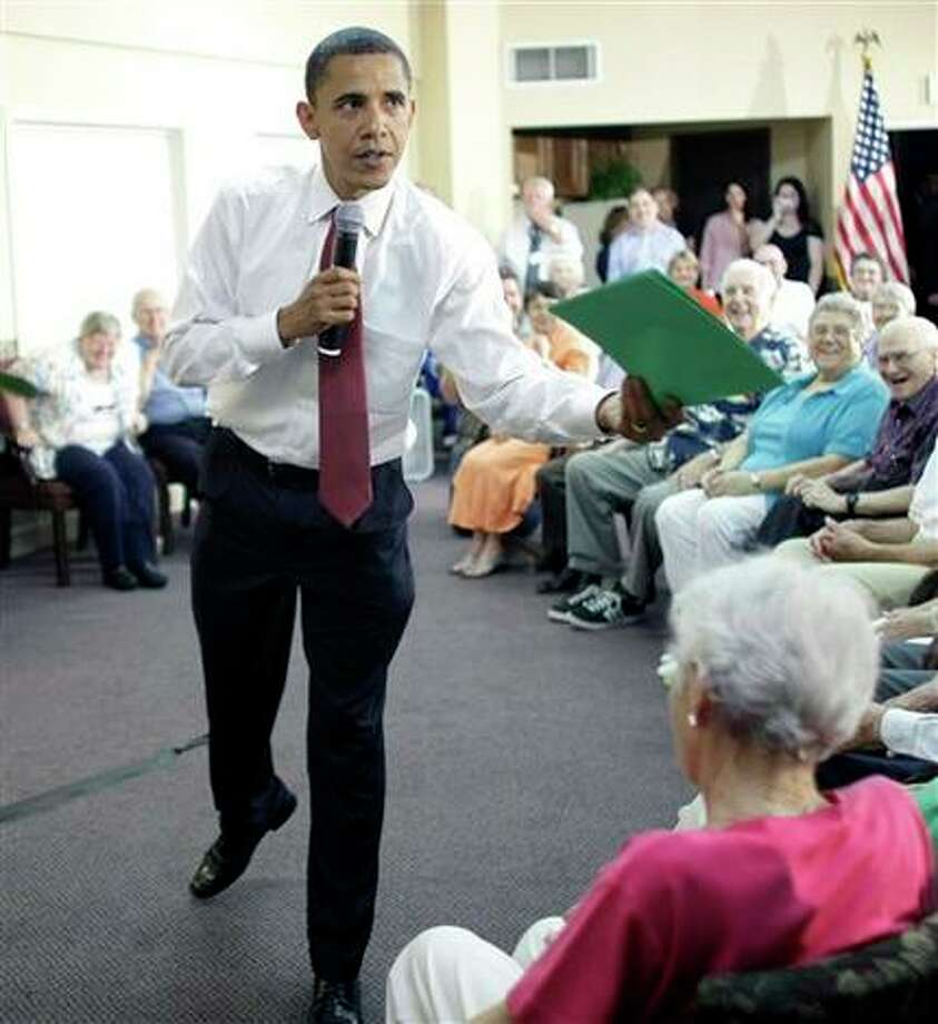 Democratic presidential candidate Sen. Barack Obama D-Ill. accepts an article from an audience member that their grandson wrote during, Friday, June 13, 2008, a speech at the Oakleaf Village retirement community in Columbus, Ohio. Photo: Alex Brandon, AP / AP