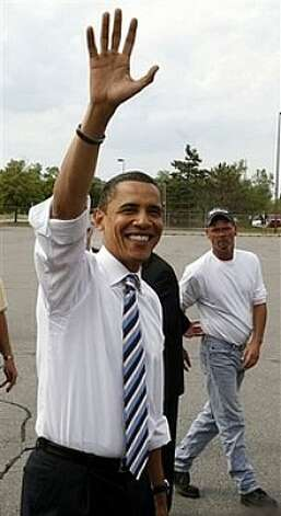 Democratic presidential hopeful, Sen. Barack Obama D-Ill., meets with workers at the Rite-Aid Distribution Center during a campaign stop in Waterford, Mich. Monday, June 2, 2008.  Obama effectively clinched the Democratic presidential nomination Tuesday, June 3, 2008, based on an Associated Press tally of convention delegates, ahead of the results from the day's final primaries in Montana and South Dakota. Photo: Chris Carlson, AP / AP