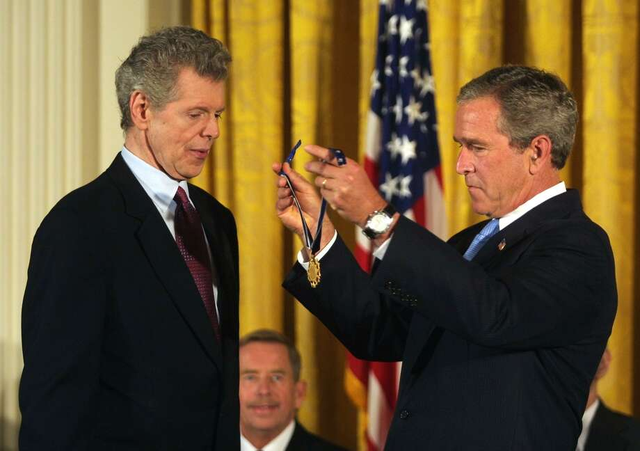 US President George W. Bush (R) awards US pianist Van Cliburn (L) with the Presidential Medals of Freedom during a ceremony in the East Room of the White House 23 July 2003 in Washington, DC. Van Cliburn was honored for his contributions to the arts and to the nation.  Former Czech President Vaclav Havel watches from behind.     AFP PHOTO/Manny CENETA Photo: MANNY CENETA, AFP/Getty Images / AFP