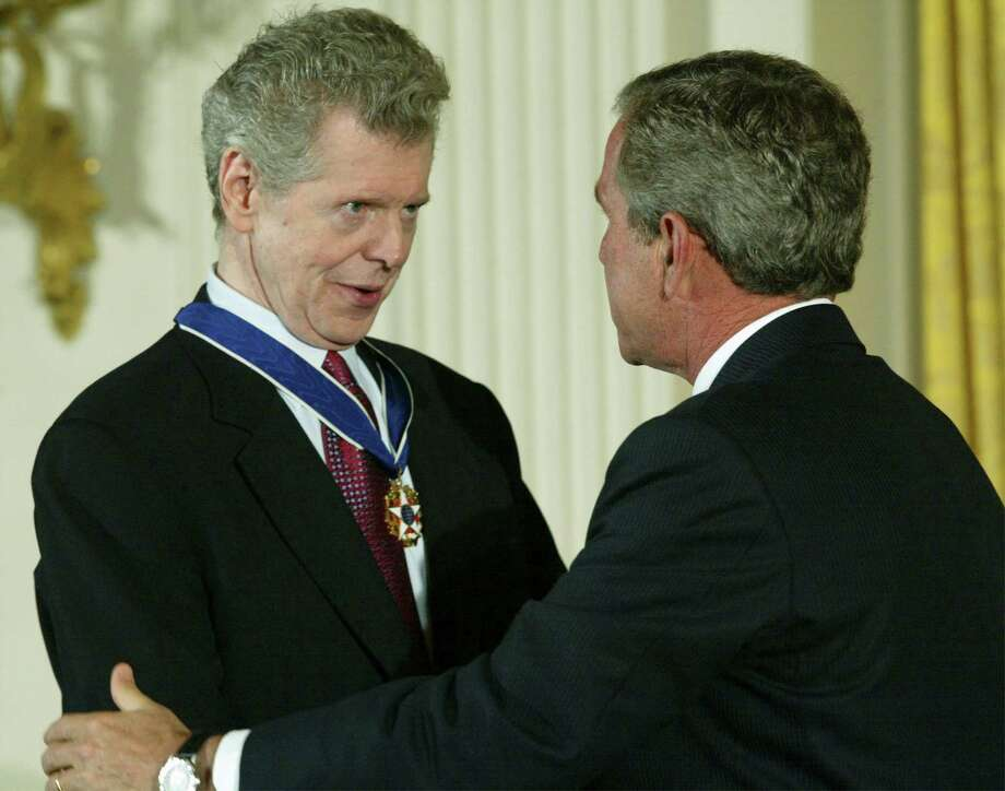 WASHINGTON - JULY 23:  U.S. President George W. Bush (R) talks to pianist Van Cliburn after presenting Cliburn with a Presidential Medal of Freedom during an East Room event at the White House July 23, 2003 in Washington, DC. Cliburn was honored as a skilled musician and for his contributions to the arts. Photo: Alex Wong, Getty Images / Getty Images North America