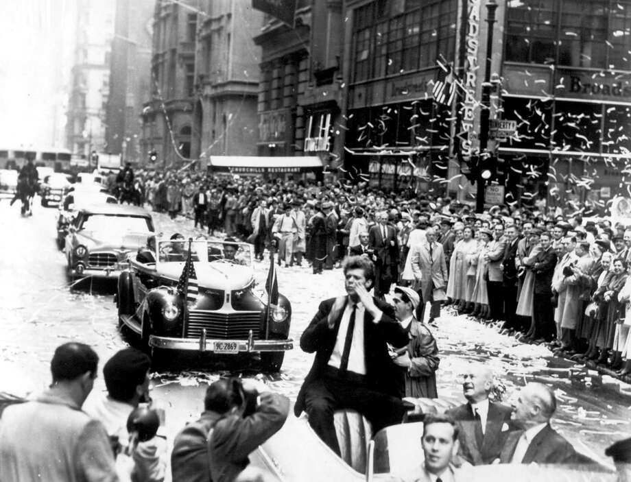 In this photo provided by the Van Cliburn Foundation, Texas pianist Van Cliburn blows kisses to fans while riding in a car in a ticker-tape parade in New York City, shortly after winning the first International Tchaikovsky Competition in Moscow on April 14, 1958. It was the first ticker-tape parade held for a classical musician. Photo: AP / Van Cliburn Foundation