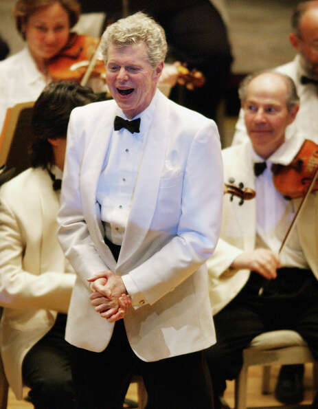 Pianist Van Cliburn, center, smiles after performing with the  Boston Symphony Orchestra as the Orch