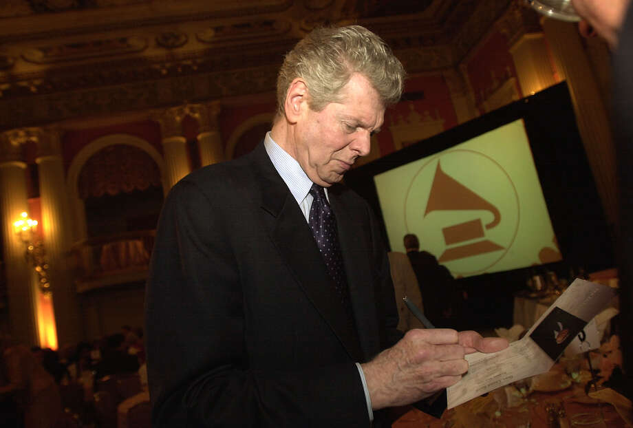 Pianist Van Cliburn, left, signs an autograph for an admiring fan at the Salute to Classical Music luncheon, Sunday, Feb. 24, 2002, in Los Angeles. In recognition of his professional achievements and role as an ambassador of the arts, the Recording Academy presented Cliburn with the President's Merit Award. Photo: RIC FRANCIS, AP / AP