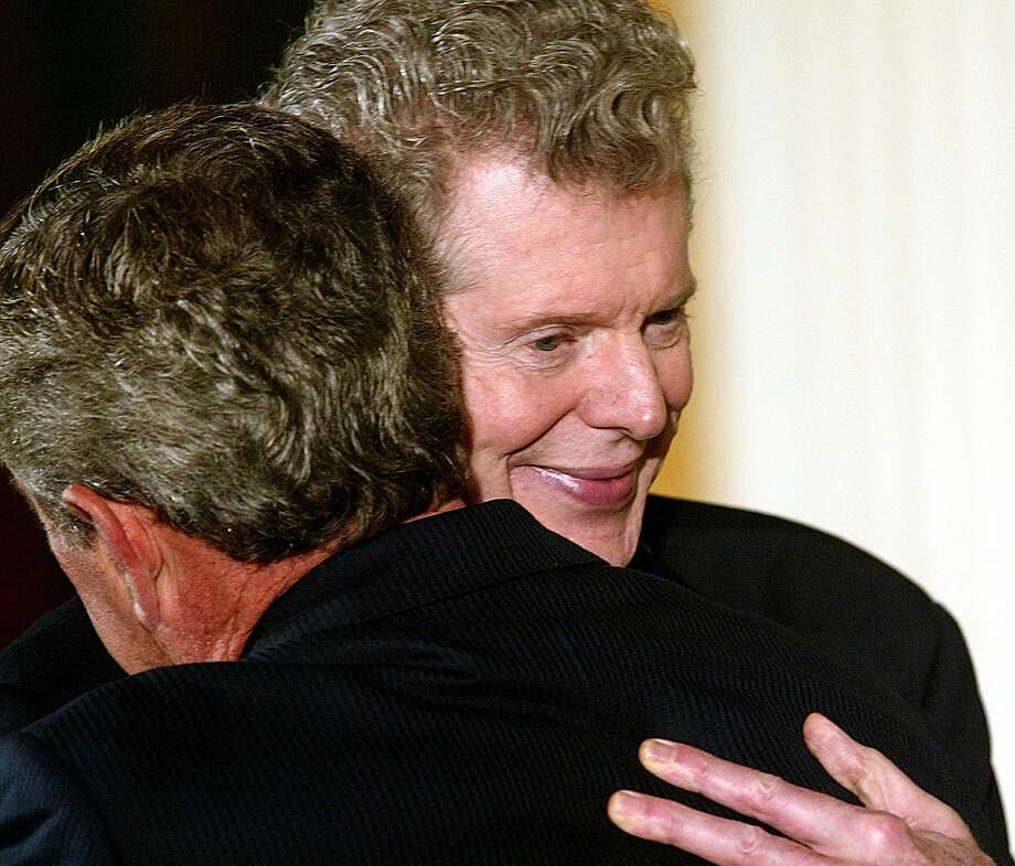 Pianist Van Cliburn (R) hugs US President George W. Bush (L) after being awarded the Presidential Medal of Freedom in an East Room ceremony at the White House 23 July, 2003, in Washington, DC. Bush awarded the medals to eleven recipients. The medal is the nation's highest civilian award, recognizing exceptional meritorious service.   AFP PHOTO/Stephen JAFFE Photo: STEPHEN JAFFE, AFP/Getty Images / AFP