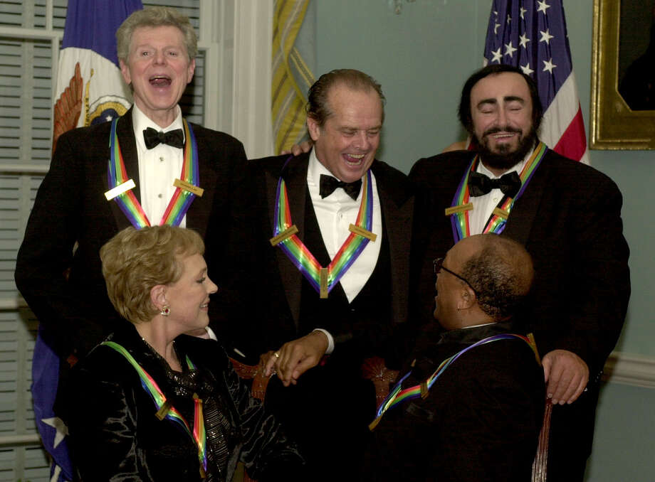 Kennedy Center Honors recipients, clockwise from background left, pianist Van Cliburn, actor Jack Nicholson, singer Luciano Pavarotti, music producer Quincy Jones and actress Julie Andrews, gather after the annual awards dinner Saturday, Dec. 1, 2001, at the State Department in Washington. Photo: LINDA SPILLERS, AP / AP