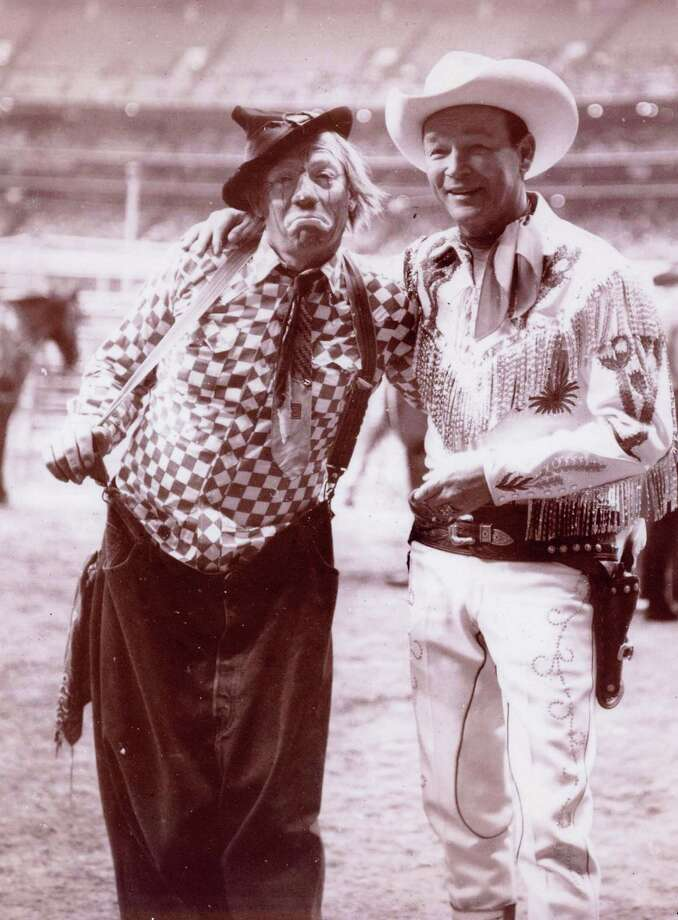 Are you the next winner of our rodeo photo contest? Beginning Thursday, go to Chron.com/RodeoPhoto to submit your entries. Until then, take a look back on all of the vintage fun at Rodeo Houston.Todd L. Gaudin sent in this shot of his dad, DJ Gaudin, also known as the Kajun Kidd, with Roy Rogers in the Astrodome. Gaudin was a bullfighter and clown for the Houston rodeo for 25 years.  Photo: Reader Submission
