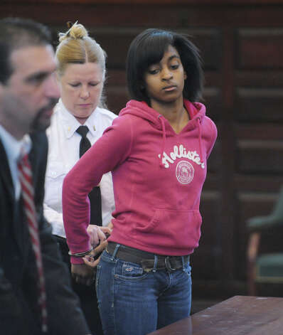 Keyanna Bradley, right, is handcuffed following  her arraignment on Wednesday, Feb. 27, 2013 at the  Rensselaer County Courthouse in Troy, NY.  Bradley was arraigned on charges stemming from the robbery and murder of Takim Smith.  (Paul Buckowski / Times Union) Photo: Paul Buckowski