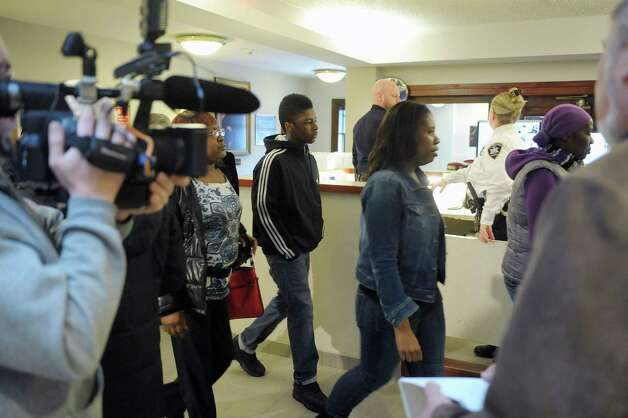 Family members of Keith D. Ferguson leave the courtroom following Ferguson's arraignment on Wednesday, Feb. 27, 2013 at the  Rensselaer County Courthouse in Troy, NY.  Ferguson was arraigned on charges stemming from the robbery and murder of Takim Smith.  (Paul Buckowski / Times Union) Photo: Paul Buckowski