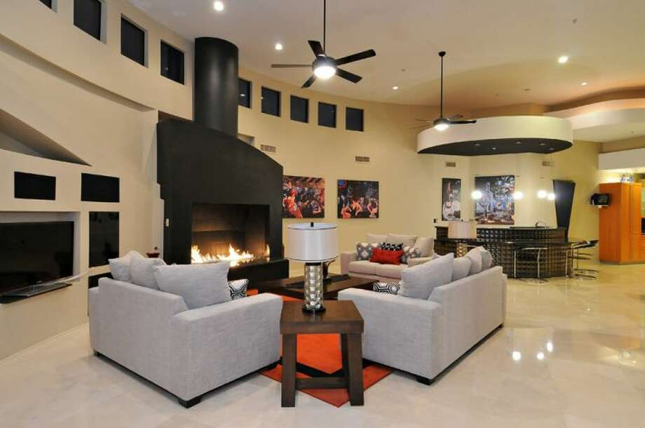 Huge, asymmetrical fireplace in the seating area of the great room