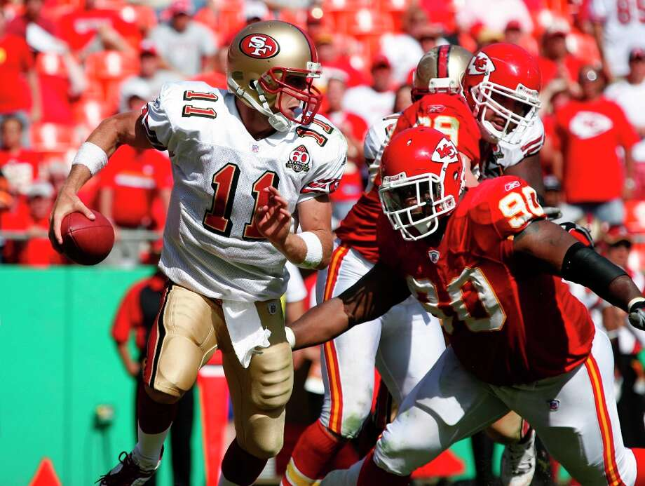 49ers Quarterback Alex Smith (#11) is chased by Kansas City Chiefs defensive tackle Ryan Sims (90) in the 4th qtr., San Francisco 49ers vs. Kansas City Chiefs at Arrowhead Stadium in Kansas City, MO  on Sunday, October 1, 2006. Photo: Darryl Bush, SFC / The Chronicle